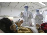 Kinijoje koronaviruso aukų skaičius artėja prie 1 400